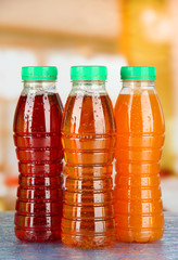 Assortment of bottles with tasty fruit juices