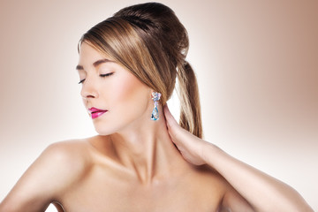 Fashion model posing in exclusive jewelry