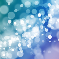 White bokeh on teal, blue, and purple background