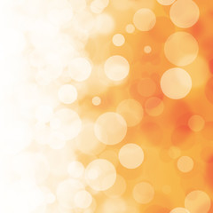 White bokeh on orange background