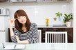 young asian woman relaxing in the kitchen