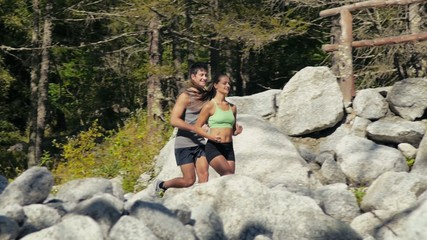 2of4 Young man and woman running on mountain trail, sport