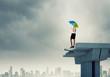 Businesswoman standing on bridge