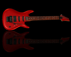 rote Gitarre auf schwarzen HIntergrund