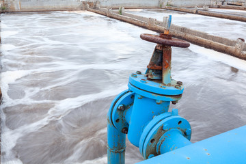 Industrial tap with blue pipeline for oxygen blowing into sewage