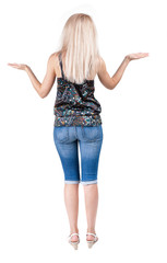 back view of surprised beautiful  blonde young woman with hands