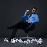 Businessman throwing a crumpled paper with bad ideas
