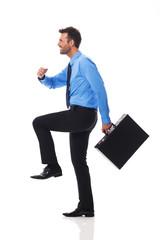 Self confident businessman climbing for success
