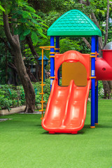 Red Dual Slides for Children on Green Lawn