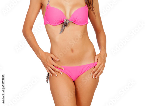 Attractive female body with pink swimwear