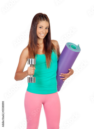 Funny girl in sportswear with a mat and dumbbell