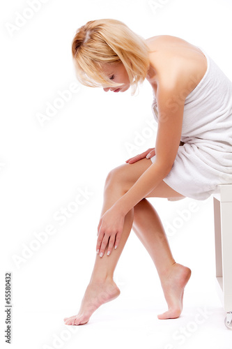 woman sitting and stroking legs