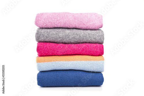 a stack of woolen jumpers