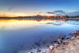 Torun old town reflected in Vistula river at sunset, Poland - 55581809