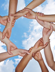 Group of hands forming a chain