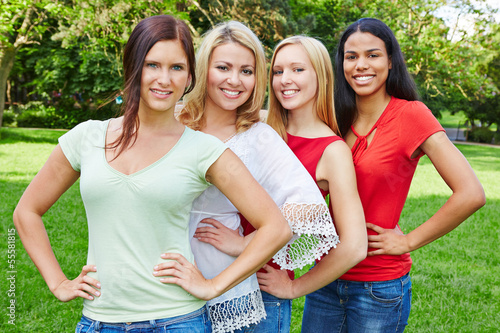 Group of four happy women in nature