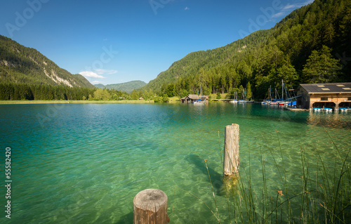 Landscape with crystal-clear water of Weissensee