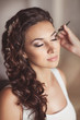 Beautiful bride with wedding makeup hairstyle. newlywed woman
