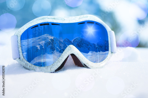 Ski mask close-up and mountain reflection