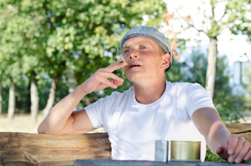 Man sitting outdoors smoking