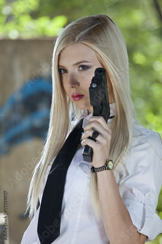Gun Woman in shirt and tie