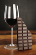 Glass of red wine and chocolate bar