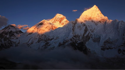 Golden peak of Mount Everest (8848 m)  on sunset.