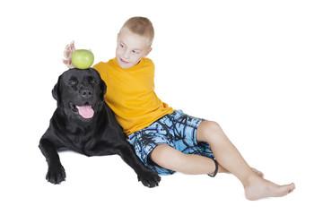 boy steals an Apple on his head dog