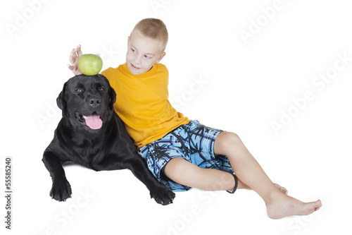 boy steals an Apple on his head dog
