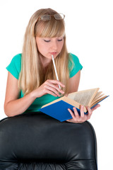 thoughtful girl with a pencil and the book of