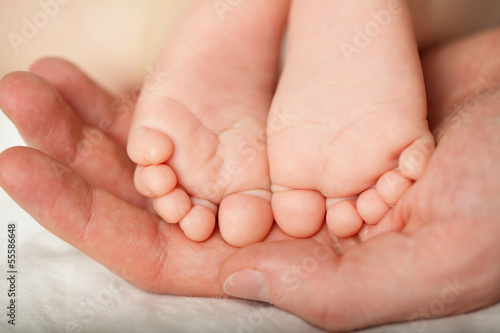 Happiness concept - newborn foot, macro