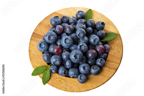 Wooden bowl with blueberries