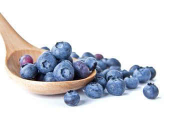 Blueberries in a wooden spoon