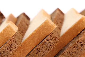 Slices of brown and white bread.
