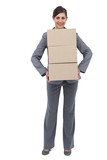 Smiling businesswoman carrying cardboard boxes