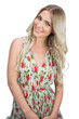 Cheerful attractive blonde wearing flowered dress posing