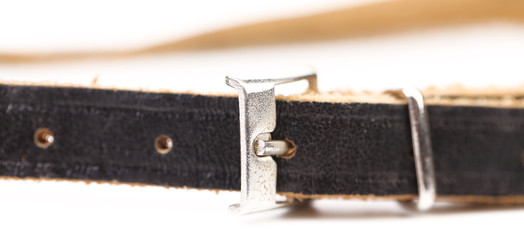 Black leather belt with a rectangular buckle