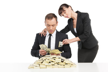 Bribing. Cheerful young businessman counting money while woman i