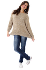 Attractive Smiling Young Woman Wearing Jeans and a Woolen Jumper