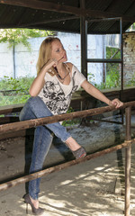 The beautiful girl costs into old  shooting-range