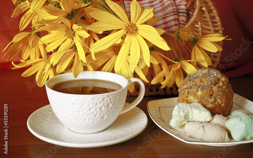 Coffee, sweets and flowers