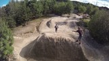 Aerial of BMXer Tailwhip on Dirt Jumps