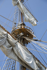 Mast with collected sails at windy day