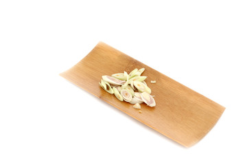 Fresh Lemon Grass and Slice it in black dish on white background