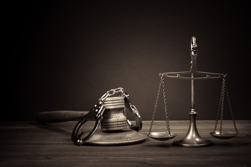 Law scales, judge gavel, handcuff on table. Symbol of justice