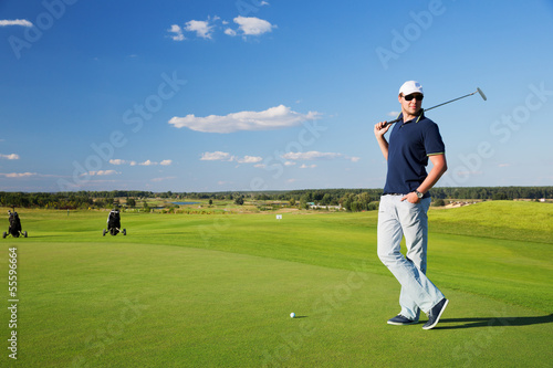 portrait of  male golf player