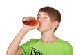 boy with bottle of juice