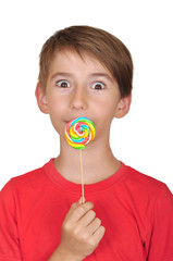 surprised boy with candy