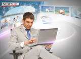 businessman with laptop pc reading news