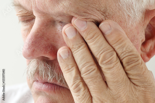 senior man has eyestrain and fatigue